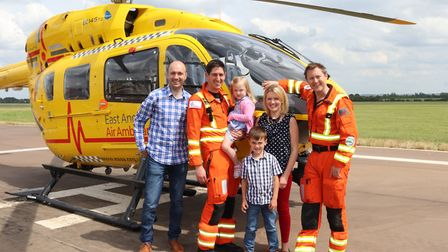Parents William and Rebecca Brightwell with children Annabel and George meet the air ambulance crew