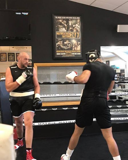 Former heavyweight champion Tyson Fury, left, sparring with Ipswich prospect Fabio Wardley. Picture:
