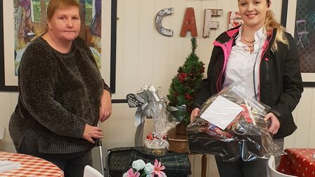 Maria Revell and PC Emma Harnett with the gifts, hamper and trolley which was donated to a 73-year-o