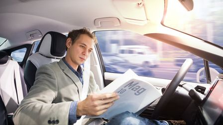 A Self driving vehicle allows you to read a printed magazine. Picture: Getty Images/iStockphoto.