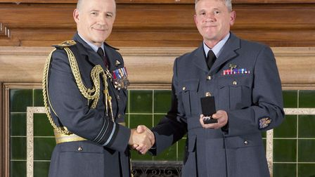 Air Marshall Stuart Atha presenting Robert Ley with his meritorious service medal. Picture: SAC JAME