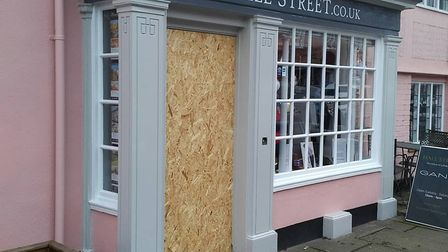Hall-Street shop has been boarded up by police following the robbery Picture: SEAN GARNHAM
