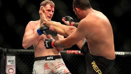Fabricio Werdum (right) and Alexander Volkov in action during a fight at The O2 Arena, London. MMA h