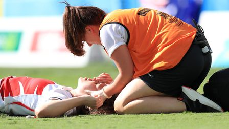 England's Emily Scarratt receives treatment for an injury in the Women's Rugby Sevens bronze medal m