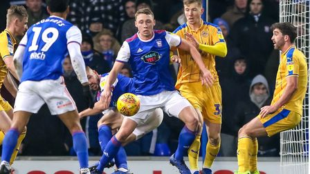 Matthew Pennington stands firm as Wigan put pressure on Town. Picture: STEVE WALLER WWW.STEPH