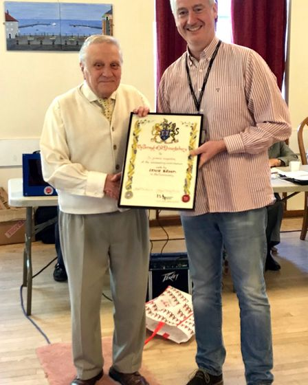 Ernie Broom (left) is presented with his scroll by town and borough councillor Paul Hopfensperger Pi