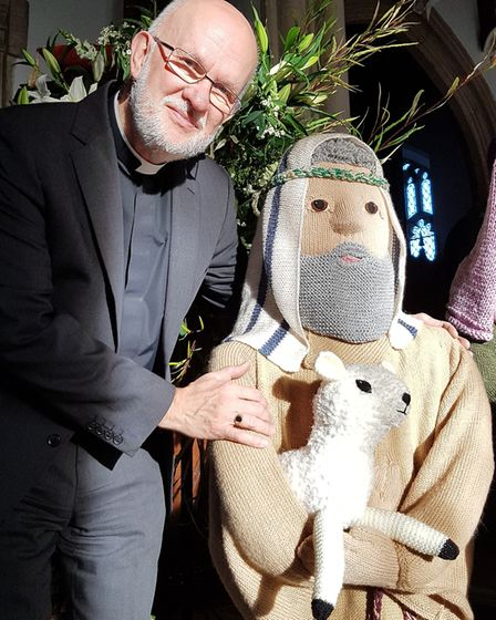 Rev Mark Lowther with one of the shepherds, a new addition to the scene this year Picture: RACHEL E