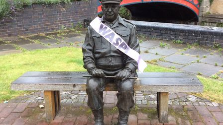 Dad's Army's Captain Mainwaring statue in Thetford wearing a WASPI sash in February 2017. Picture: P