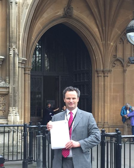 Waveney MP Peter Aldous with the WASPI campaign petition he presented to the House of Commons in 201