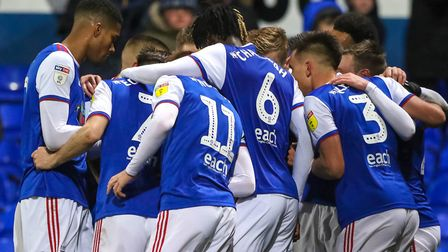 Team-mates surround Freddie Sears after his goal that gave Town victory against Wigan. Picture: S