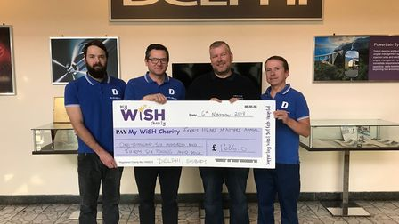 Four of the five cyclists from Delphi who took part in the cycle ride with their cheque for £1,636.1