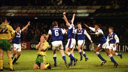 Norwich City's Gary Megson slumps to his knees after scoring a last-gasp own goal against Ipswich on