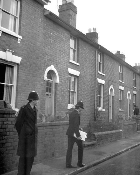 A policemen outside the house in Worcester, where the bodies of the three young children were found