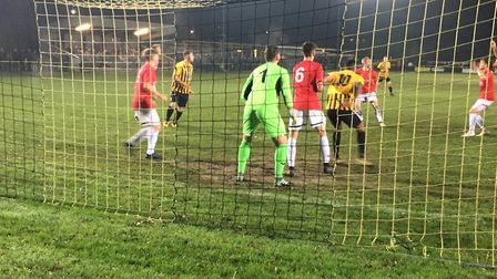Action in the Swaffham Town penalty area during the FA Vase third round replay at Greens Meadow on T