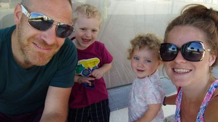 Ella and Andrew Colleran with their two children - the family lost everything when a fire ripped thr