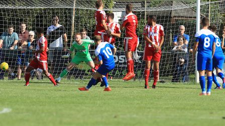 Bury's Ryan Horne, taking a free kick against Felixstowe & Walton, is suspended for the visit of Ba