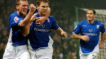Richard Naylor celebrates his goal with Jason de Vos in Town's 2-1 win over Wigan in December 2004