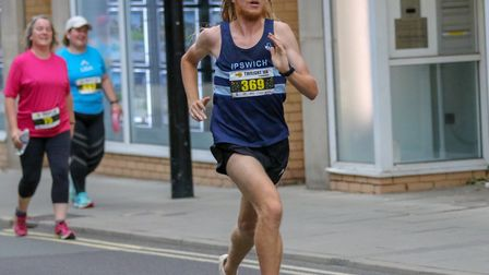 John 'Jack' Millar, strides out on his way to a superb victory at the Ipswich Twilight 10K, in a cou