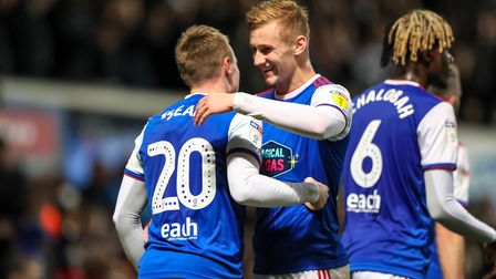 Flynn Downes congratulates teammate Freddie Sears after he had given Ipswich a 1-0 lead in the first