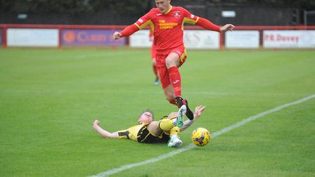 Dan Morphew, who is playing well in the heart of defence for Needham Market. He helped to keep a cle