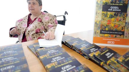 Dr Lin Berwick signing copies of her book 'God's Rich Pattern' in Ipswich. Picture: ARCHANT