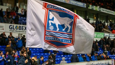 A flag bearer with a Town flag ahead of the Ipswich Town v Briston City match. Picture: STEVE WAL