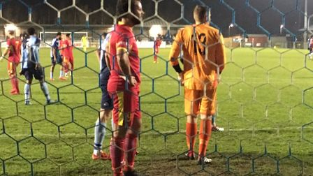 James Baker (red shirt) in the St Neots penalty area during Needham's recent 3-0 away win. Baker has