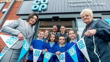 Pupils of Thurston Primary School help open the store Picture: JASON BYE