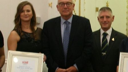 Terry Hunt stands beside Lisa Perry who saved his life in May Picture: SADS