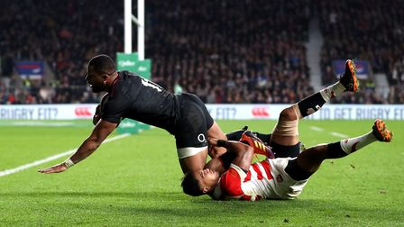 England's Joe Cokanasiga (left) scores his side's third try of the match against Japan during the Qu