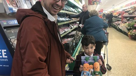 Peter Xavier shopping in Aldi for carrot toys with his five year old son. Picture: Jessica Hill