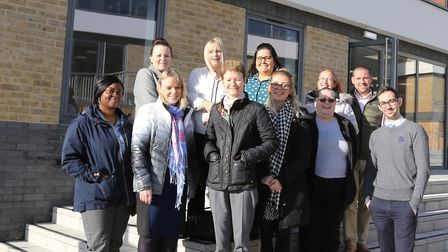 Colne Housing staff outside their new office with Knowledge Gateway head of operations Jamie Burns a