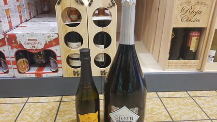 The three-litre bottle of Prosecco next to an average bottle of wine. Picture: WILL JEFFORD