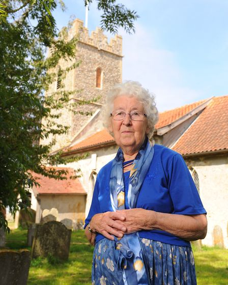 Dolly Bloomfield outside St Michael's church, South Elmham, where her father Jack Page is buried