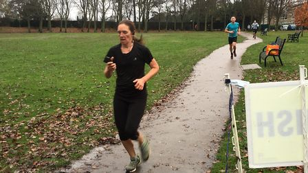 Approaching the finish of the Barclay parkrun, on wet paths in Barclay Park, Hoddesdon. Picture: CAR