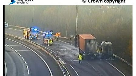 The lorry has now stopped burning and is being dampened by firefighters Picture: HIGHWAYS ENGLAND