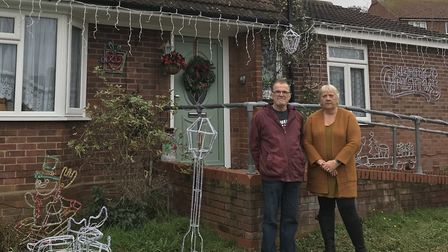 Adrienne and Graham Thompson have been putting up Christmas lights for years. Picture: SOPHIE BARNET