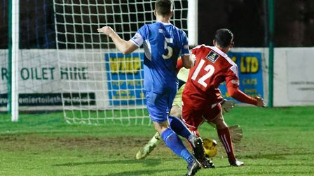 Stourbridge substitute Kaiman Anderson slots the ball past Charlie Beckwith for their third goal. Pi