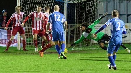 Stourbridge's James Wren gets a hand down to keep out Kyle Hammond's (no 2) low shot. Picture: PAUL