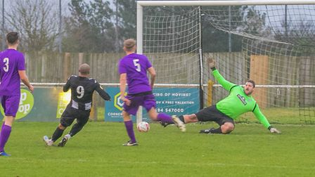 Kelsey Trotter sends the Melford keeper the wrong way for Woodbridge. Picture: PAUL LEECH