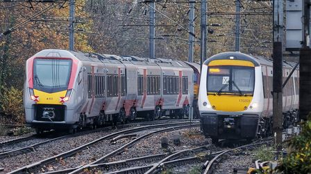 New trains built by Stadler in Switzerland (left) are now arriving in East Anglia and will be replac