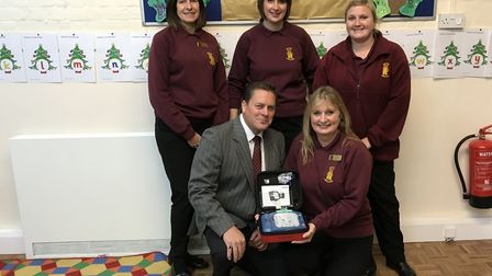 Darren Webb of Mixbrow and Shelley Symonds with other member of the Barking pre-school group, Needha