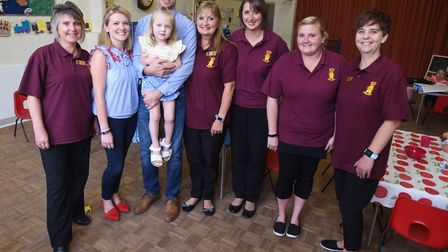 Annabel Brightwell with parents William and Rebecca and staff at Barking preschool group after they