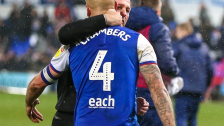 Luke Chambers and Town manager Paul Lambert embrace after Town's 1-0 victory over Wigan. Picture: