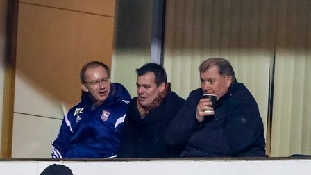 Marcus Evans (on the left) pictured during the Wigan victory alongside Lee O'Neill and Dave Bowman.