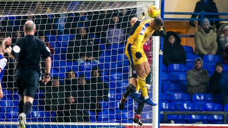 Dean Gerken is fouled by James Vaughan late in the game as Wigan look for an equaliser. Picture: