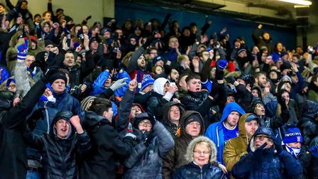 Town fans celebrate at the final whistle after their clubs first home win since April. Picture: S