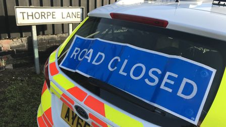 Thorpe Lane has been closed to traffic while officers work at the scene of the crash Picture: NEIL