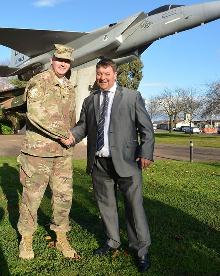 Colonel William L Marchall (left) shaking hands with the Leader of Forest Heath District Council, Ja