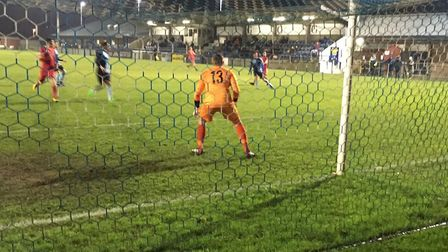 St Neots keeper Harry Reynolds prepares to save this effort from Adam Mills in the first half. Reyno